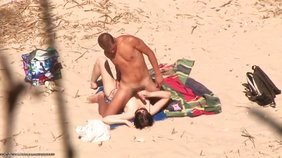 Dude viciously tit-fucking his nudist GF on a beach
