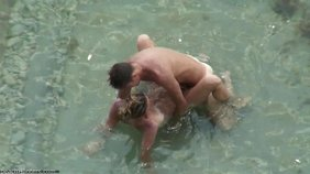 Nudist couple enjoying hot cowgirl sex underwater