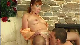 Redheaded MILF in stockings fucks a random dude in this amateur video