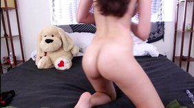 Big booty dark-haired teen fucking her own pussy with a massive toy