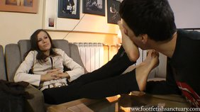 Two girlfriends humiliate their foot slave on cam