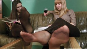 Pantyhose-wearing and wine-drinking GFs in a foot fetish scene