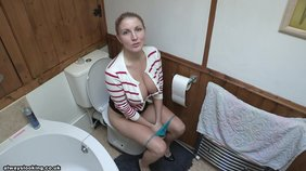 Someone naughty is picking on busty blonde peeing on a toilet