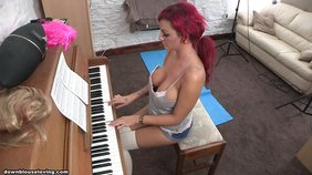 Redhead with a ponytail showing off her piano-playing skills to the partner