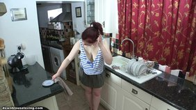 Redheaded hottie with a great body showing her tits in the kitchen