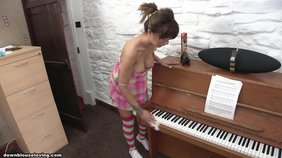 Striped stockings brunette tries to move a piano while also topless
