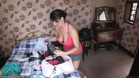 Thick brunette folding clothes and giving you a good amount of downblouse action