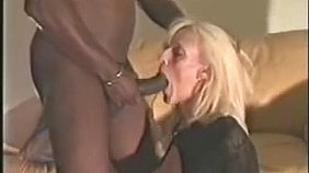 Bodysuit wearing MILF blonde enjoying a huge black cock, two of them actually