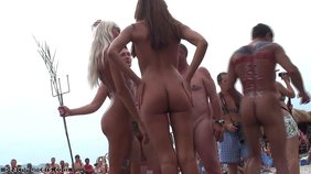 Nudist chicks showing their sexy bodies during a weird celebration