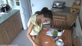 Amazing-quality downblouse video featuring a tanned hottie in a checkered skirt